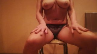 masturbating on a chair in a sexy thong